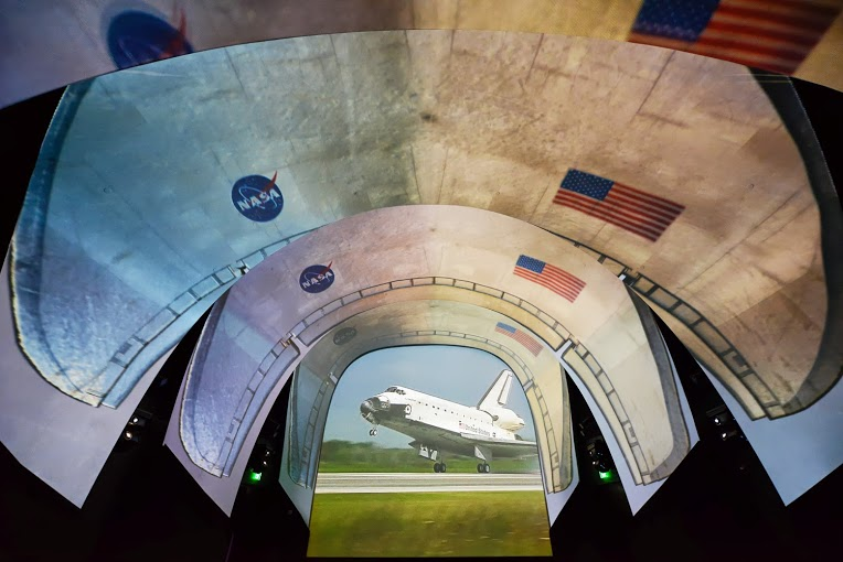 Atlantis Space Shuttle Projection on the arched Fellert Acoustic Plaster screen